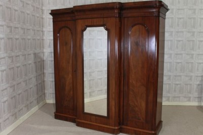 Antique breakfront wardrobe