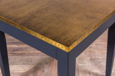 restaurant table with brass top