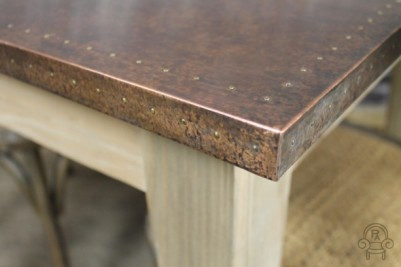 table with studded copper top