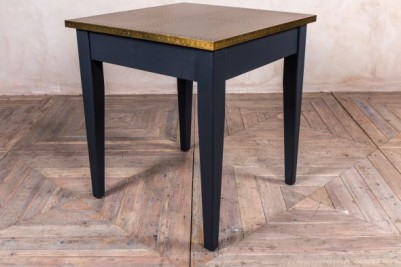 tapered leg table with brass top