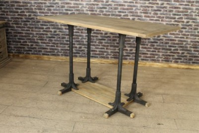 tall oak and cast iron table