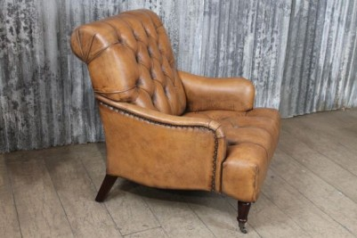antique style buttoned armchair