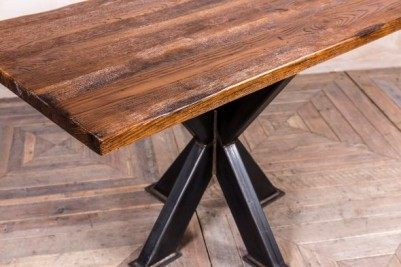 tank trap table with large antique finish top