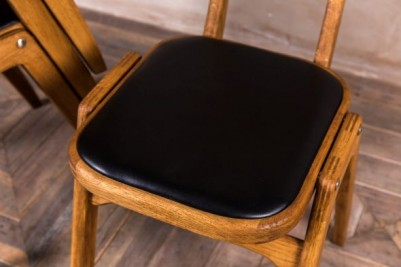 black upholstered seat pad