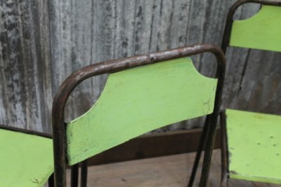 green metal stacking chair