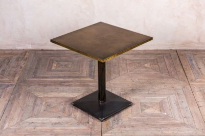 brass topped dining table