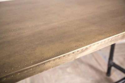studded brass table