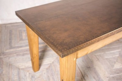 unpainted wooden copper top table