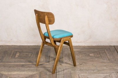 ben style chair with blue seat