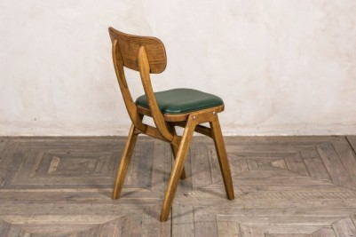 ben style chair with green seat