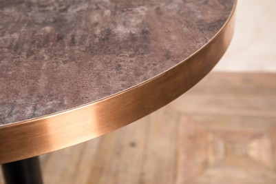aged brass edged circle dining table