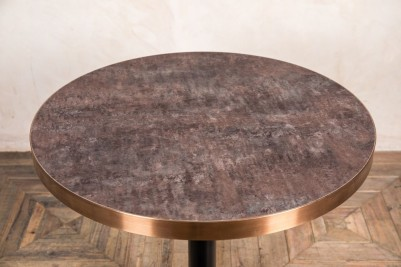 aged brass edged dining table circular