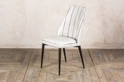 white ribbed restaurant chair
