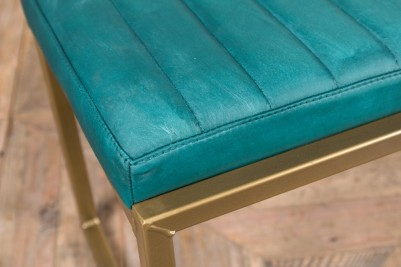 blue faux leather and brass frame bench