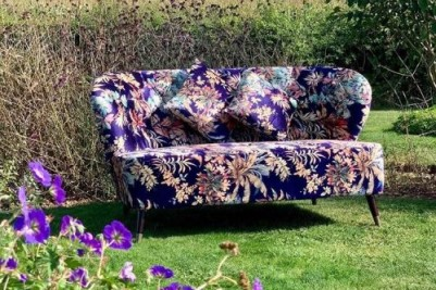 Photo Credit: @thehappyheartcompany - purple sofa and flowers