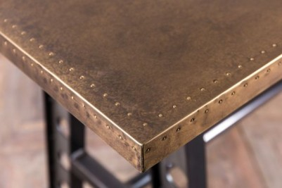 a frame table with brass top