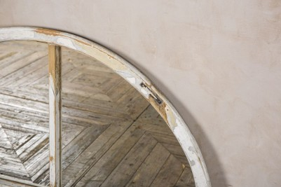 arched mirrored window