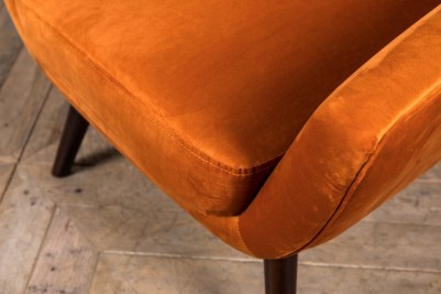 burnt orange retro style armchair