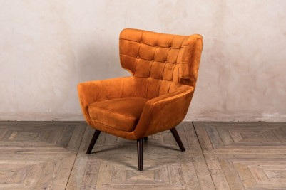 burnt orange velvet armchair