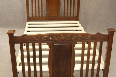 Art Nouveau red walnut bed