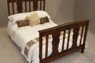 Art Nouveau red walnut double bed