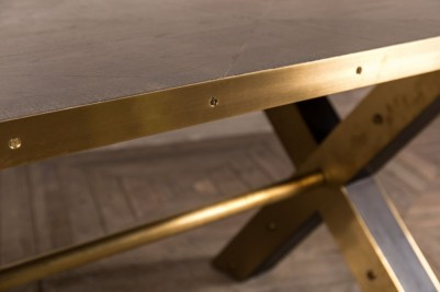 large brass edged dining table