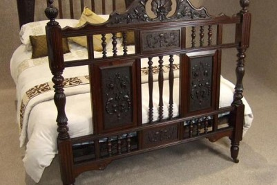 Carved walnut antique bed