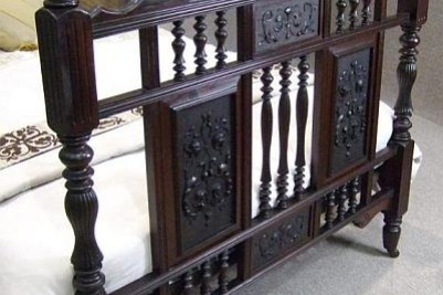 Carved antique walnut bed
