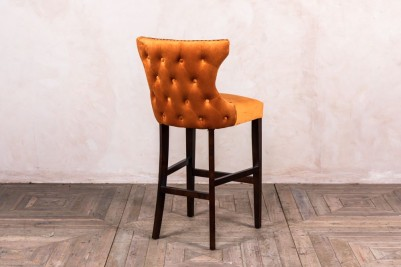 burnt orange button back stool
