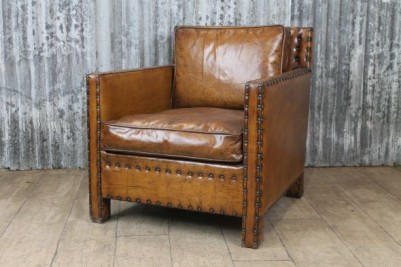 aged brown leather chair
