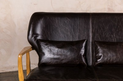 dark brown leather bench