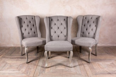 upholstered dining chairs in stone