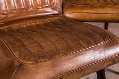 tan ribbed leather chairs