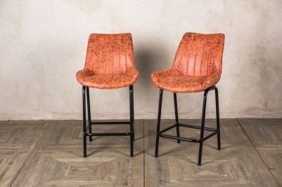short orange bar stools