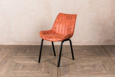 orange faux suede chairs