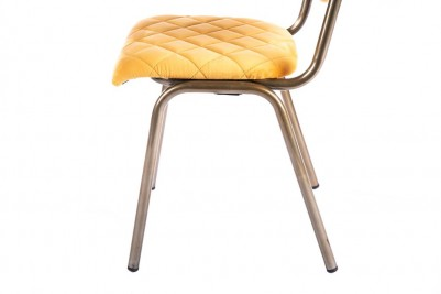 yellow brass leg chair