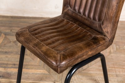 brown stitched leather seat