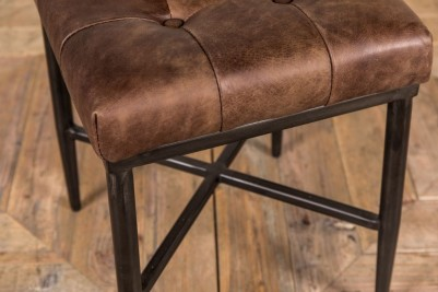 brown leather footstool and metal frame