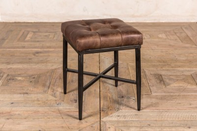 small brown footstool