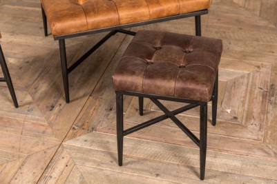 small brown leather footstool