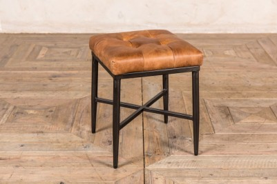 small tan foot stool