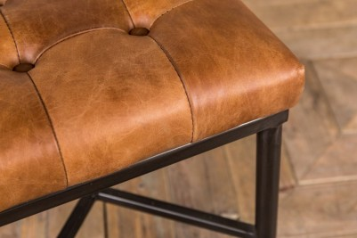 tan leather button back footstool