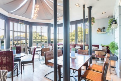 Photo Credit: Pitcher and Piano - leather style restaurant chairs in orangery