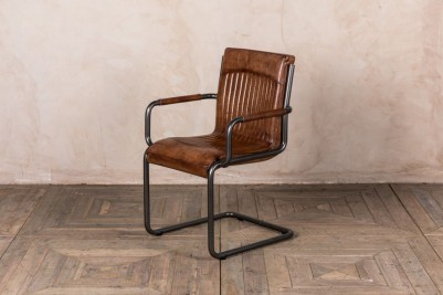 aged leather carver chair