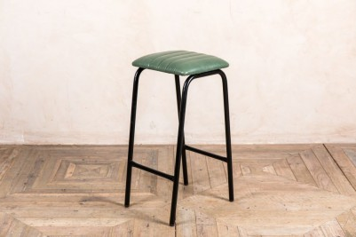 green faux leather bar stool