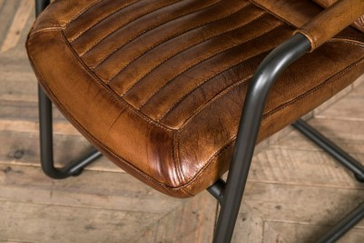 tan leather carver chair