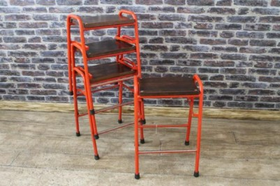 industrial stacking stools with red frames