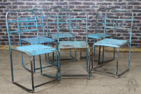 Light blue stacking chair with RIJ in back