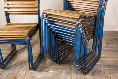 blue slatted stacking chairs