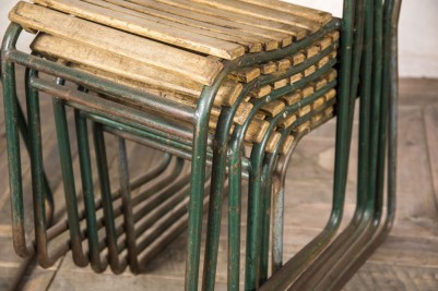 green slatted stacking chairs